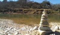 Pedernales River with random cairn