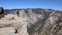 Austin Explorer standing near the edge of Taft Point overlooking Yosemite Valley.