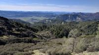 The trail crosses over the spine of a ridge and opens up views of Napa Valley more to the north.