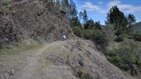 Many segments of the trail hug a steep rock wall on one side.