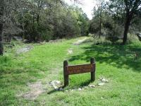 The trailhead is located in back of the main park visitor's center.