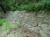 The stone retaining walls of the winding trail demonstrate the craftmanship of Heinrich Kreische.