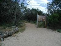 The trailhead resides at the back of the loop road that encircles the park lake.