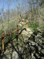 Steeper sections of the trail have retaining walls and railings.