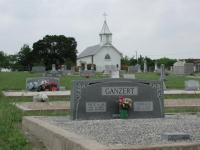 A wide angle view of the cemetery with a Ganzert family marker in the foreground.