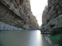 The trail ends with the canyon walls near vertical entry into the river.