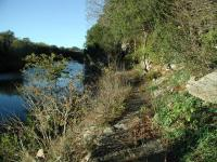 Much of the trail follows the edge of a rock cliff overlooking the San Gabriel River.