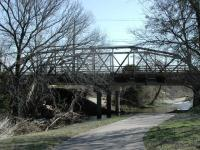 A pedestrian bridge next to Old Dessau Road appears to be using an old railroad bridge.