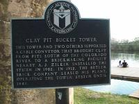 The historic plaque at the base of the tower