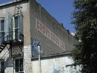 Grove didn't paint over the old Morley sign up front, but he did have this painted at the back of the building.