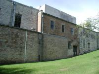 Note the newer brick walls which link up the two older, once separate, buildings.