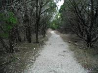 The trail near the trailhead is composed of gravel. That soon changes in about a quarter mile.