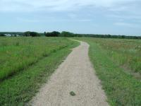 The trail on the western side of the park is wide open, with little shade.
