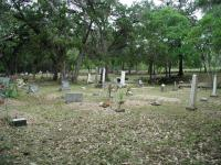 A wide shot of the cemetery.  Older stones are to the right and center.