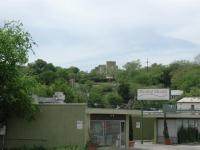 From 12th Street opposite of Lamar Boulevard, the old TMI building sits high atop a ridge.