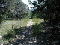 The back corner of the loop contains the steepest portions of the hike.  The park boundary is the fencing on the left.